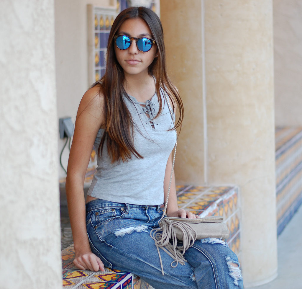 Boyfriend jeans gray top sitting close