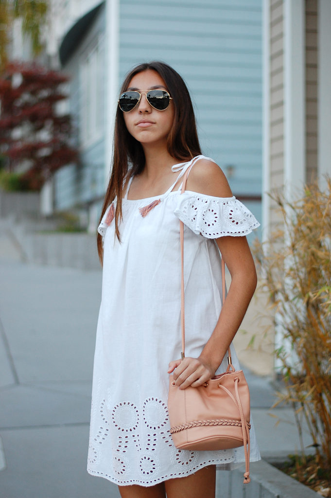 White cold shoulder dress side close