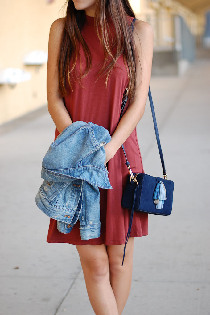 red dress denim jacket close