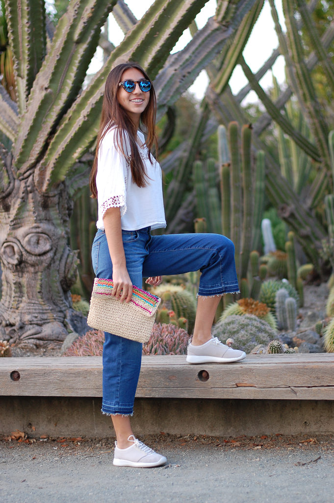 White crop top cropped jeans leg