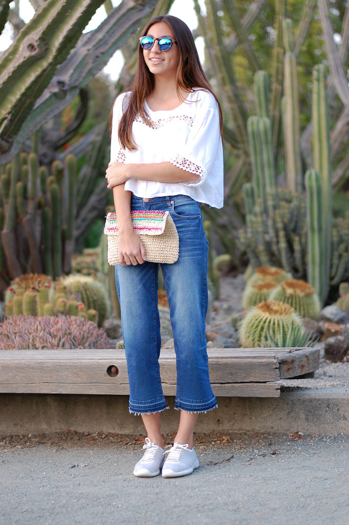 White crop top cropped jeans smile