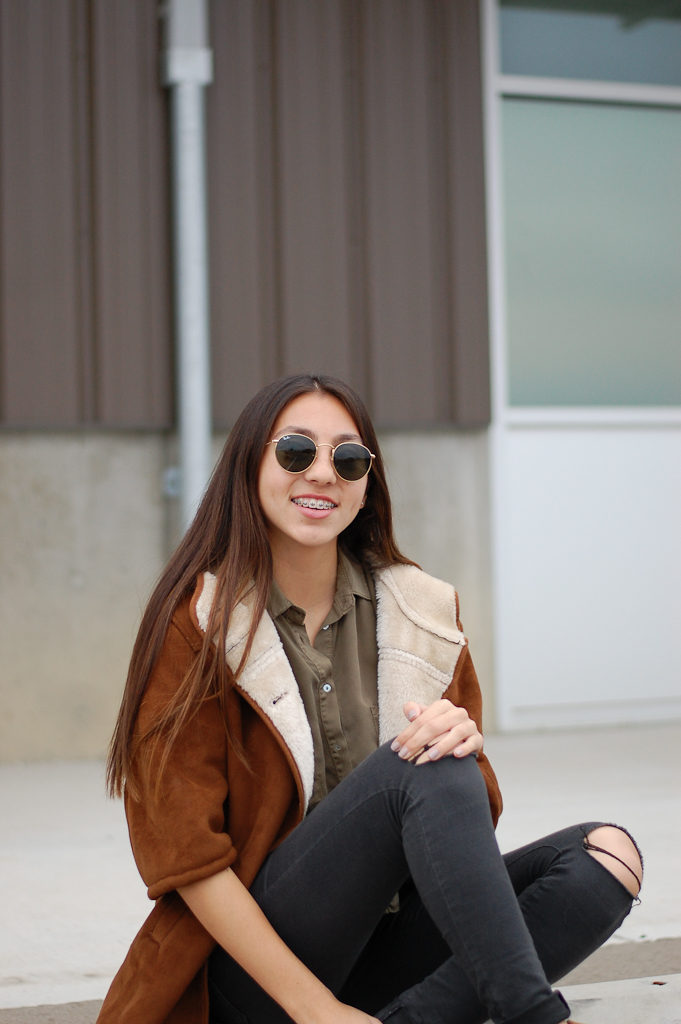 black jeans warm coat smiling