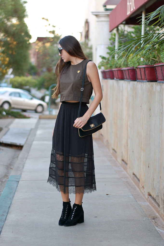 green top black skirt