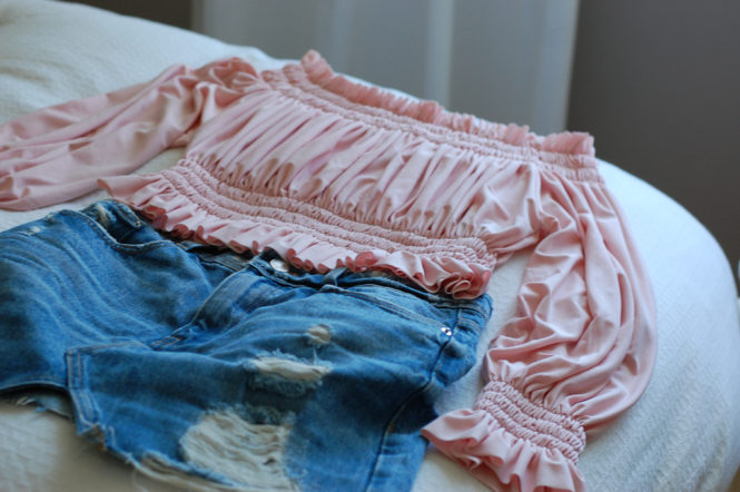 Pink off the shoulder top Denim skirt Flatlay