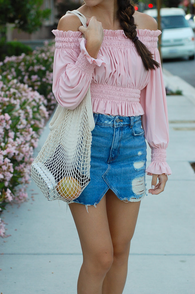 Pink off the shoulder top Denim skirt center